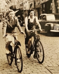 My mother, Maria Roose (left) and, I believe, my aunt Denise Hutsebaut riding their bicycles ont he Steenstraat in Bruges, c1950-1955