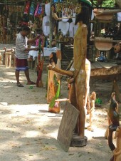 """""""Big Bamboo"""" carving at Fern Gully carving stall, c2003 (photo: Marc Rammelaere - all rights reserved). The sign leaned against the sculpture says: """"take a picture and leave a tip"""""""